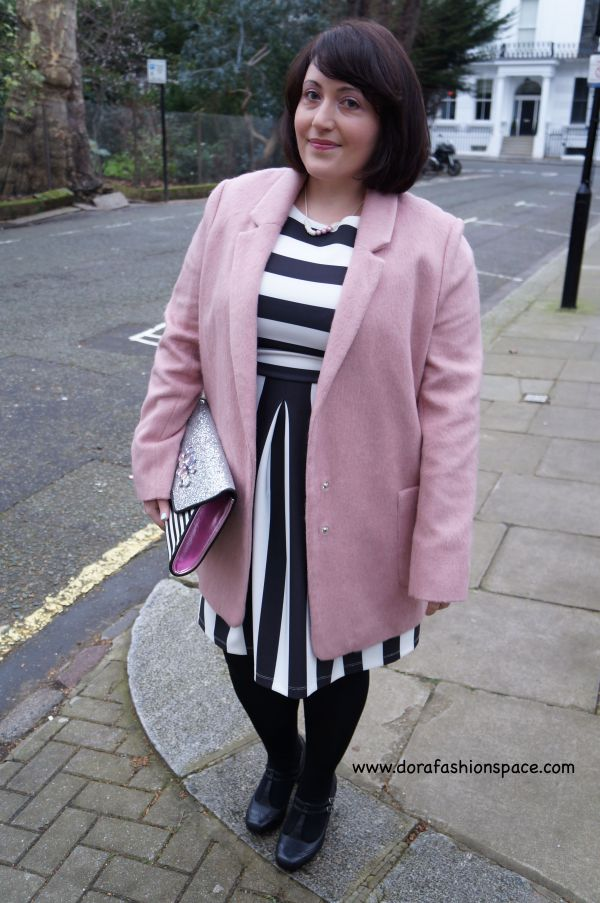 pink coat with striped dress