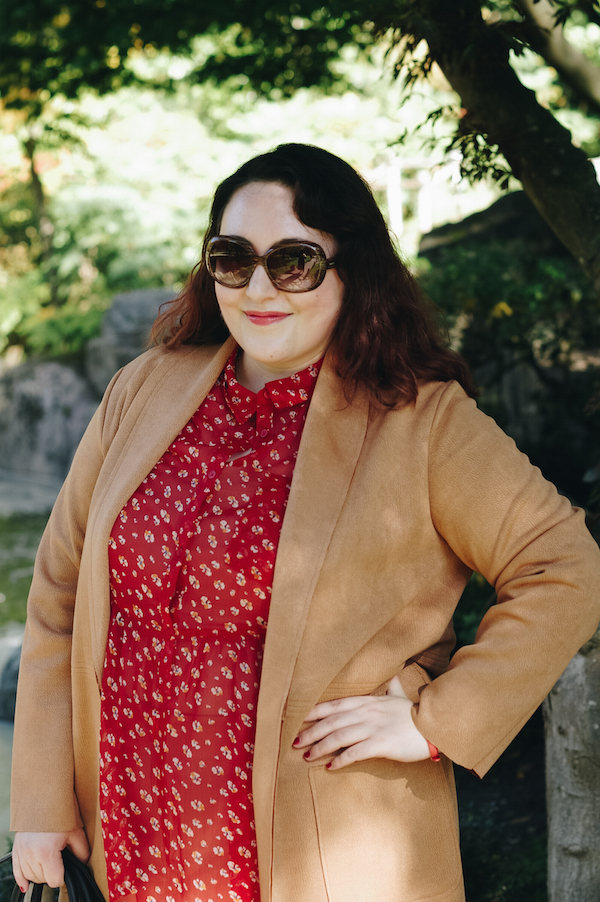 red floral blouse with camel coat